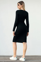 Černé tlačítko detailu svetr šaty