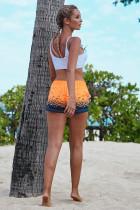 Oranssi merenrantapainatut naiset uimashortsit