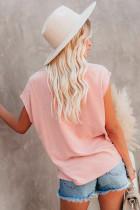 Maglietta rosa con tasche e spacchi laterali