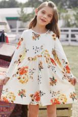 Květinové bílé houpací šaty se skrytými kapsami