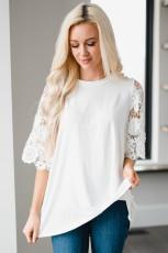 Biała tunika z koronkowymi rękawami