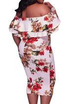 Robe mi-longue blanche à fleurs et épaules dénudées