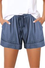 Kék, rugalmas derékhúzó lány nadrág zsebbel