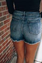 Short en jean bleu délavé moyen avec patchs marguerites