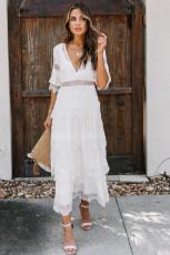 Vitt schweiziskt prickigt genomskinligt spetslapp i lager lång klänning