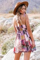 Mini-robe évasée à patchwork de fleurs et bretelles spaghetti