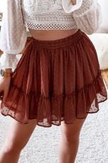 Mini-jupe rouge rouille en mousseline à taille élastique et à pois