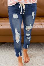Blå snøring elastisk midjehull revet jeans