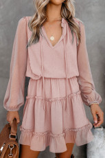 Mini-robe rose à volants et à pois suisses