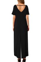 Černá jednobarevná kombinéza s krátkým rukávem a širokými nohavicemi s kapsou