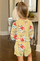 Keltainen pikkutyttöjen kukkainen pitkähihainen Romper