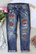 Jeansy z patchworkowym wzorem w panterkę ze średnim stanem