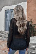 Musta pilkullinen röyhelöinen paita