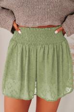 Neformální šortky se švýcarskými tečkami v zeleném pasu