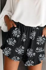Musta palmu lehtien painettu, joustava vyötärö shortsit taskulla