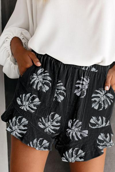 Czarne szorty z nadrukiem liści palmy z elastyczną talią i kieszenią