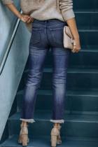 Modré zúžené džíny se středním pasem se zapínáním na knoflíky