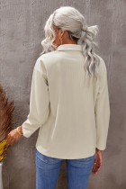 ベージュのポケットボタンリブ編みテクスチャードジャケット