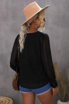 Musta V-aukkoinen puff-paita sveitsiläisillä paitapuseroilla