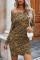 Brun miniklänning med rynkad nederkant i leopardmönster