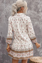 Blommig tryckt puffärmad knappad skjorta miniklänning