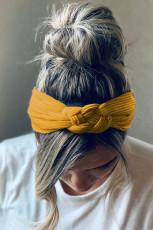黄色の編みこみの広いヘッドバンド
