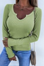 Grön, rundad ribbstickad topp med rund hals
