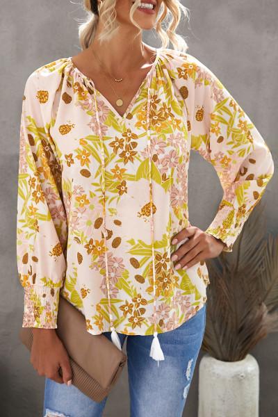 Gelbe Bluse mit Kordelzug und V-Ausschnitt mit Blumenmuster und Ärmeln