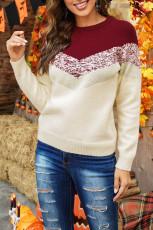 Maglione a blocchi di colore con motivo a righe rosse a V