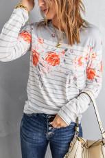 Top a maniche lunghe con stampa floreale a righe bianche