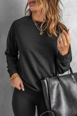Zwart sweatshirt met ronde hals en raglanmouwen