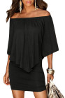 Vestido de poncho negro con múltiples capas de aderezo múltiple
