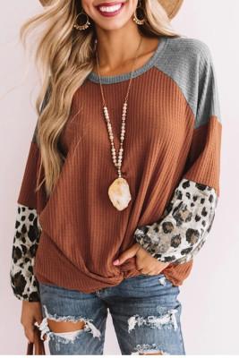Blusa de leopardo de manga larga de punto de gofre naranja con nudo torcido