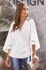 Blusa cruzada de crochet blanca