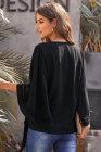 Blusa cruzada de crochet negra