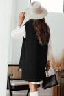 Schwarzer Strickpullover mit Strickweste