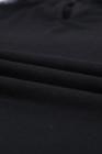 بلوزة طويلة الأكمام من الدانتيل باللون الأسود