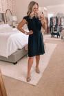 فستان قصير بأكمام مكشكشة أسود