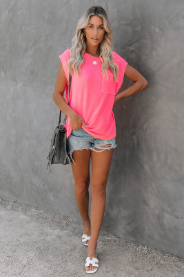 Camiseta con bolsillos en rosa y aberturas laterales