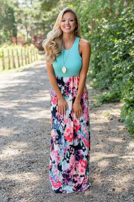 Vestido largo liso con falda floral y empalme sin mangas