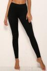 Pantalones pitillo elásticos de cintura media con empalme de leopardo negro