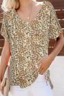 Camiseta amarilla de leopardo con bolsillo delantero y cuello en V