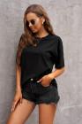 Camiseta negra de gran tamaño con cuello redondo