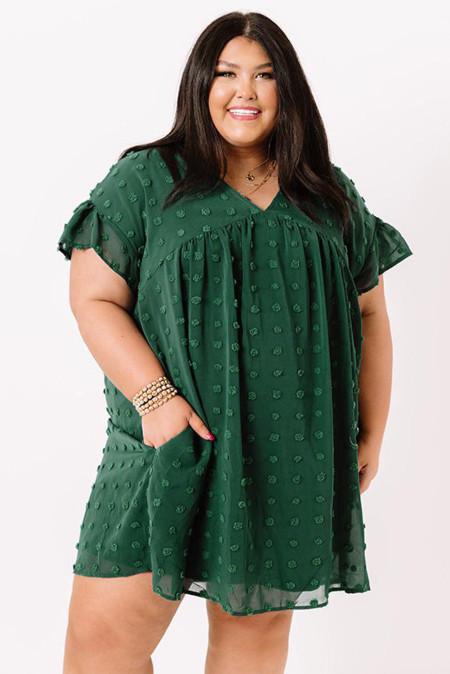 Mini vestido verde con cuello en V y volantes de lunares suizos con bolsillo