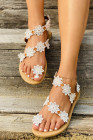 Flache Sandalen mit Blumenapplikation und Zehensteg