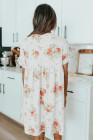 Vestido floral con cuello en V y manga ondulada