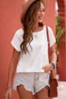 Camiseta beige con bolsillos y aberturas laterales