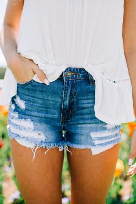 Pantalones cortos de mezclilla desgastados azul oscuro