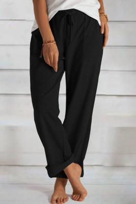 Schwarze Strickhose mit lockerem Kordelzug und Taschen