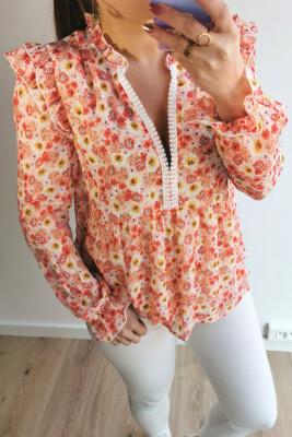Оранжевая блуза с баской с цветочным узором и оборками